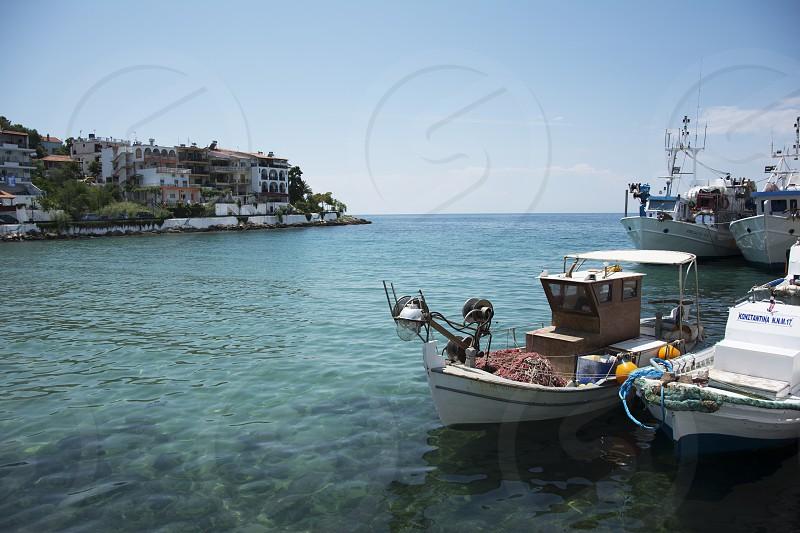 Beautiful small marine and fishing boats in turquoise sea photo