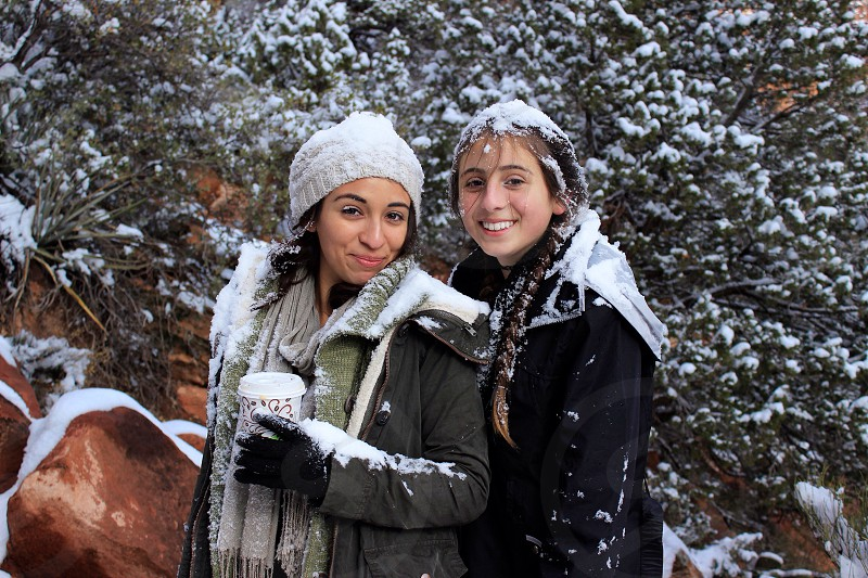Girls girl women sisters snow storm weather fashion coffee cold snowing portrait nature outdoors outside  photo