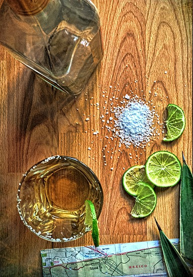 Aerial view of tequila basics with lime salt glass of and bottle photo