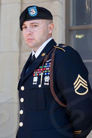 person in soldier uniform photo