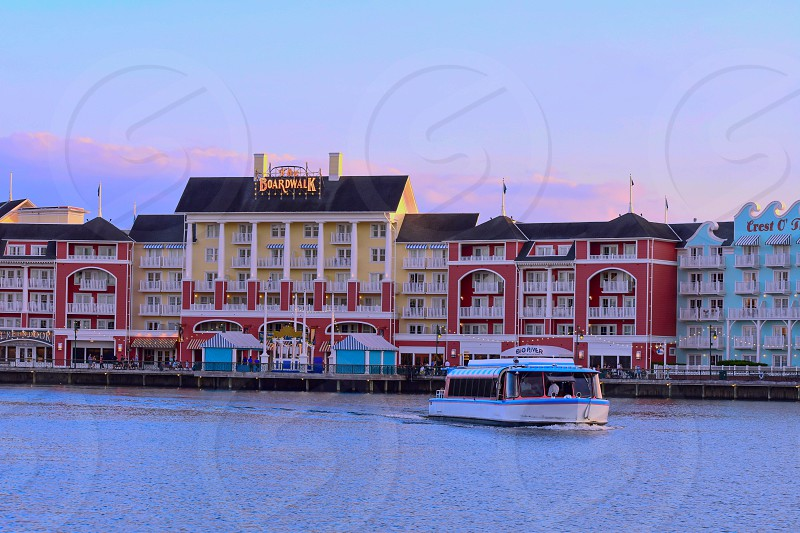 Orlando Florida. November 02 2018. Taxi Boat and colorful dockside waterfront panoramic view on sunset background at Lake Buena Vista area  (1) photo