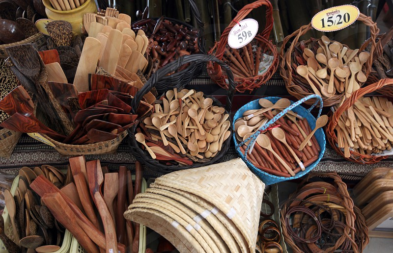 wood souveniers on a market in the city of Amnat Charoen in the Region of Isan in Northeast Thailand in Thailand. photo
