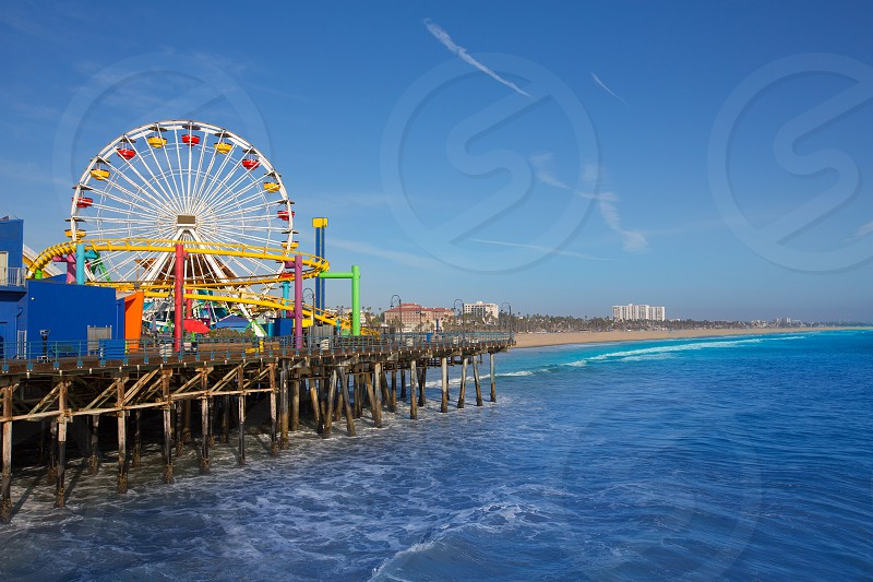 Santa Moica pier Ferris Wheel in California USA on blue Pacific Ocean photo
