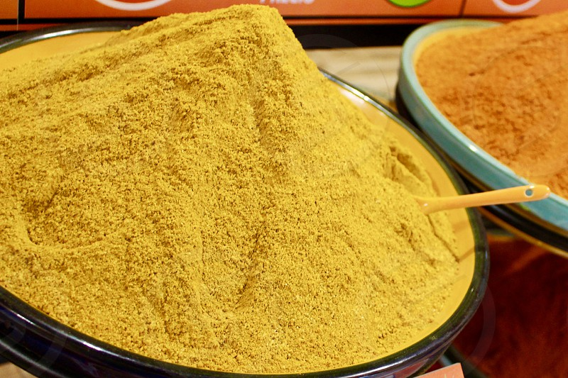 Shop with colorful spices for food curry pepper saffron photo