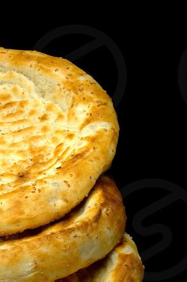 fresh just made traditional uzbek bread close up photo