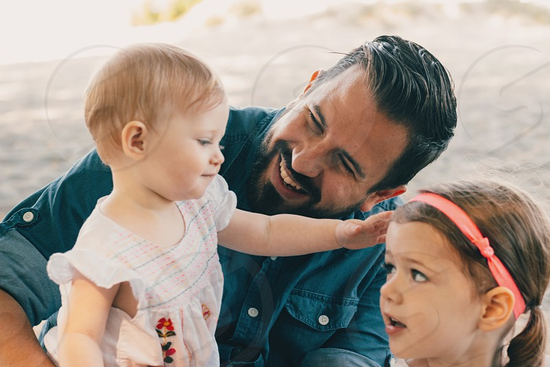 man and two children smiling photo
