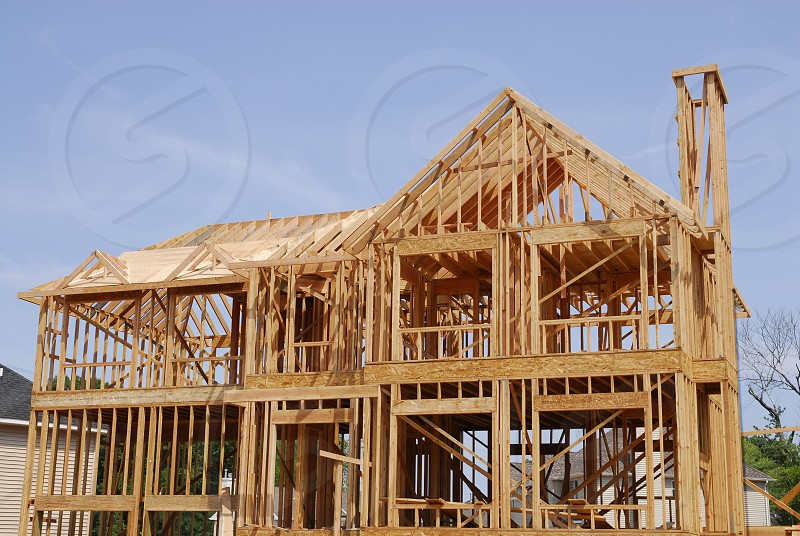 Innovation new home construction stick built skilled carpentry photo