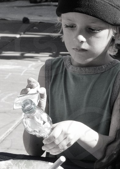 girl holding bottle grayscale photography photo