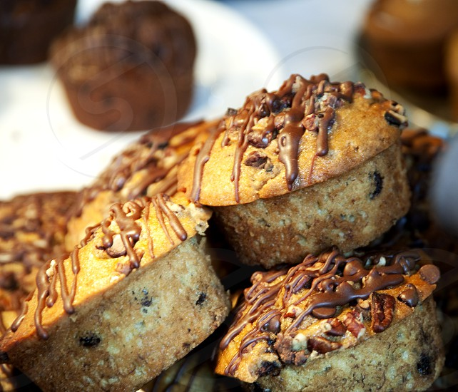 Chocolate chip muffins drizzled with chocolate photo