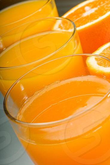 fresh and healthy orange juice unfiltered over a light table photo