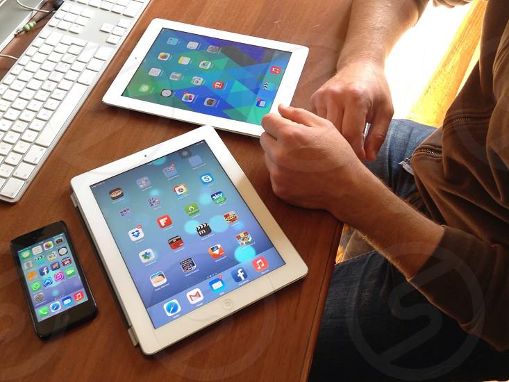 white apple ipad on wooden table photo