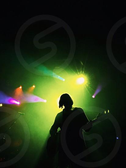 man holding guitar silhouette photo