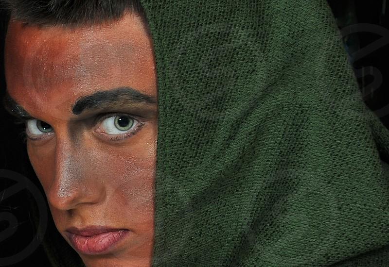 man with green hood photo