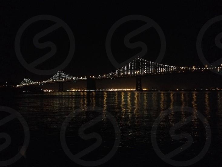 black bridge with white lights photo