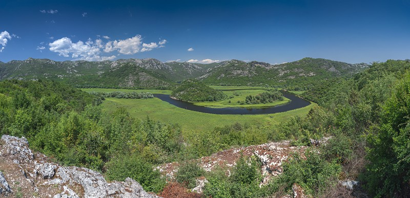 Panoramic view from above of Skadar lake and Crnojevica river in a national park Montenegro in a sunny summer day photo