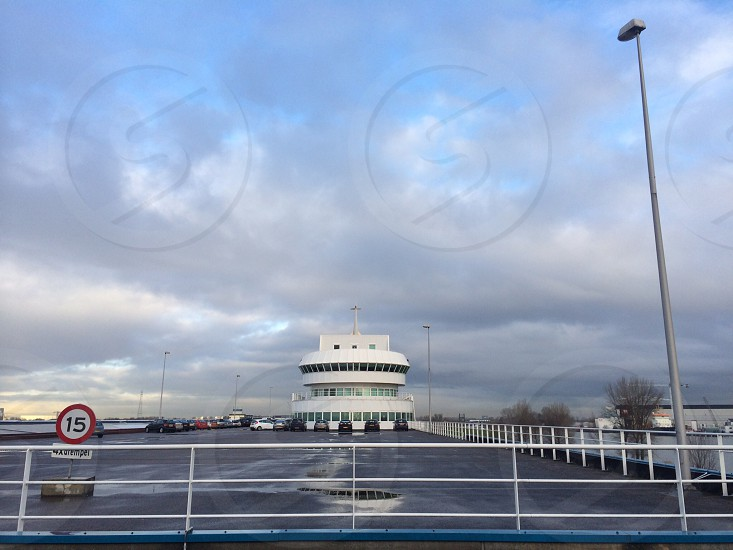 This is a cool looking carparking in Ridderkerk. It looks like a ship but actually is a business office overlooking the river the Maas. I like the big space and sky above this gives a positive vibe to the scenery! photo