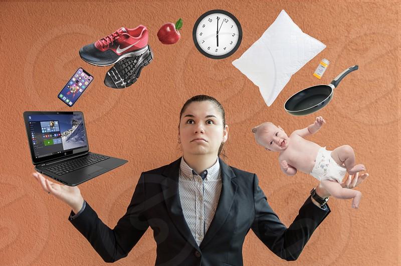 Business woman juggling responsibilities photo