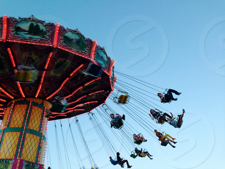 people in carnival rides photo
