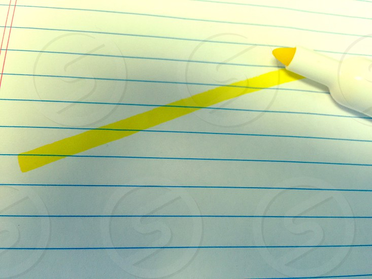 yellow highlighter on blue lined paper photo