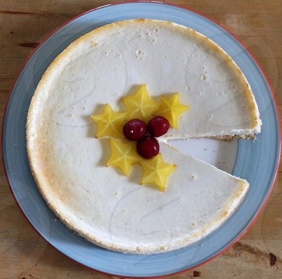 yellow star fruit and red cherry on pie photo
