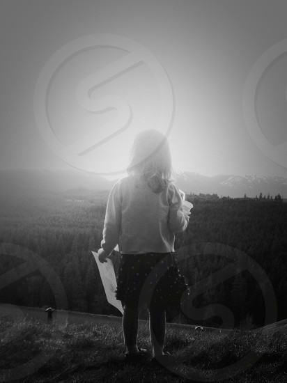 girl standing seeing the sunset view photo