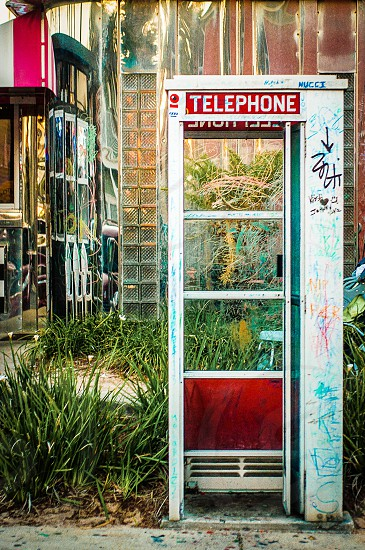 """THE ABSTRACT   My first thought when I saw this was """"beautiful"""".  A phone booth with many people's signatures who have visited this phone booth. photo"""