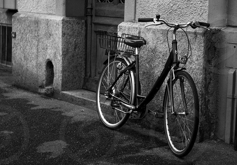 black bike with basket on back photo