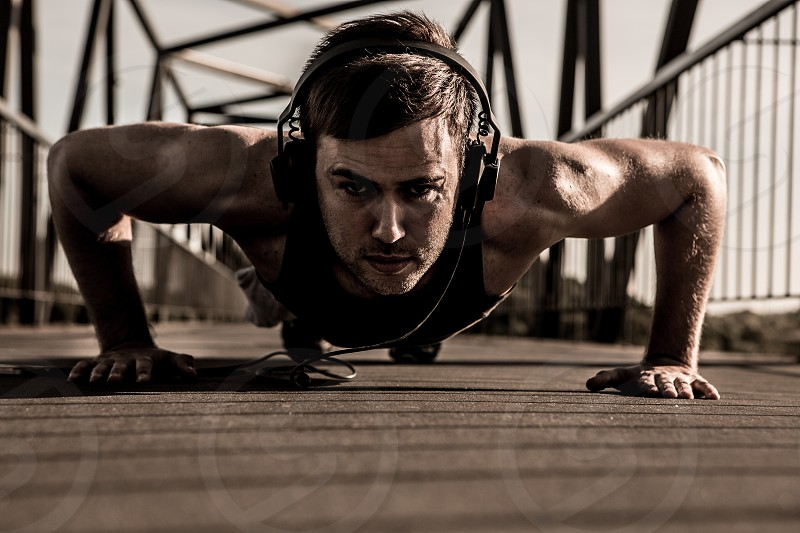 man fitness exercise headphones urban photo