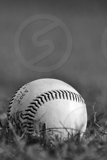 white baseball ball on grass photo