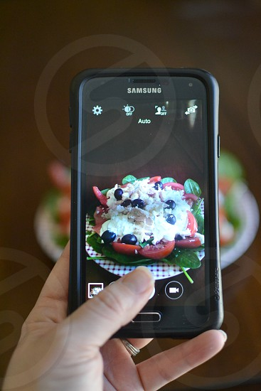 Photo of android phone taking photo of a beautiful fresh salad photo