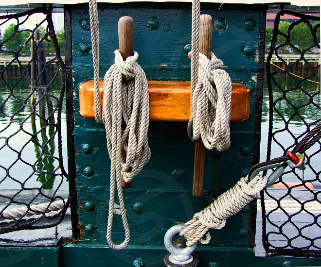 Nautical ropes tied on a ship photo