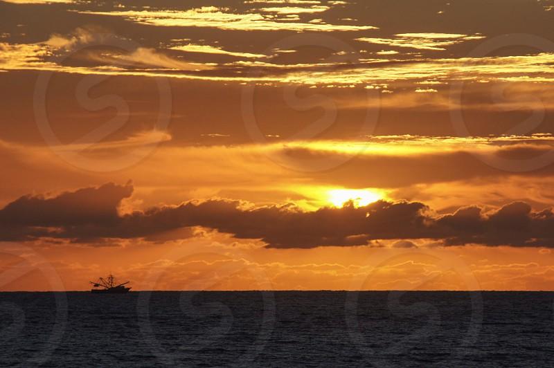 Sunrise ocean boat Atlantic Florida orange fishing photo
