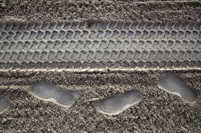 beach sand human footprint human and tyres printed  photo