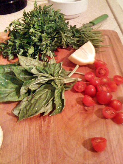 sliced cherry tomatoes beside green vegetables on brown surface photo