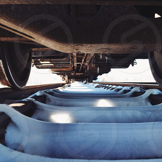 a view of rail road under a train  photo
