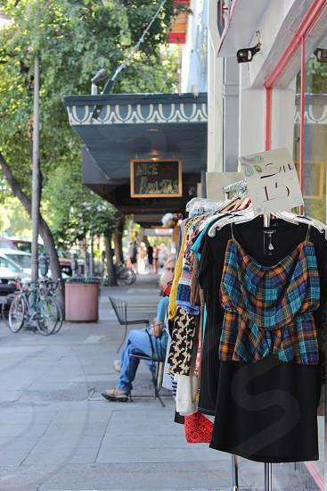 rack of clothes on sidewalk photo