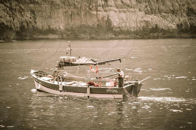 Fisherman tending to his nets photo