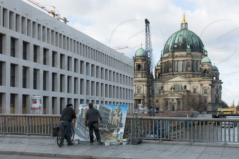 Berlin Cathedral - Berlin.     Berlins largest and most important  church seen with a artist painting it. photo