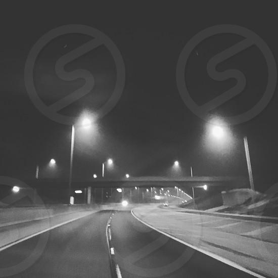 Empty road at night photo