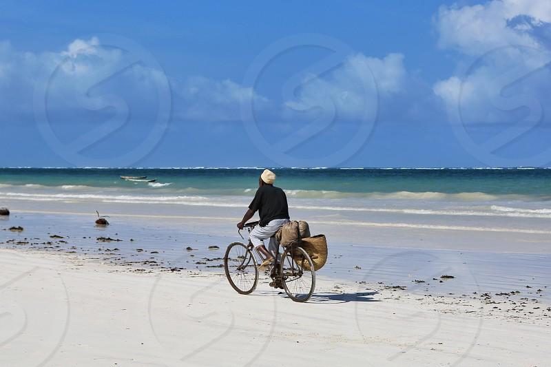 Mombasa  Africa  Kenya  ocean beach bike trip vocation man rest sand sky waves nature holiday summer season photo