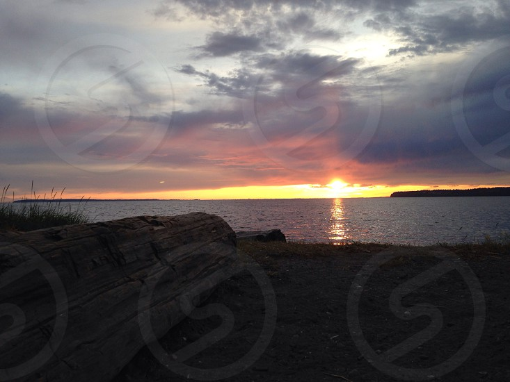 sunset scenery on body of water photo