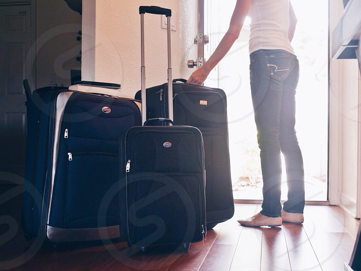 black and silver luggage on floor photo