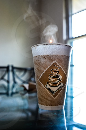 Coffee cup with hot steaming coffee photo