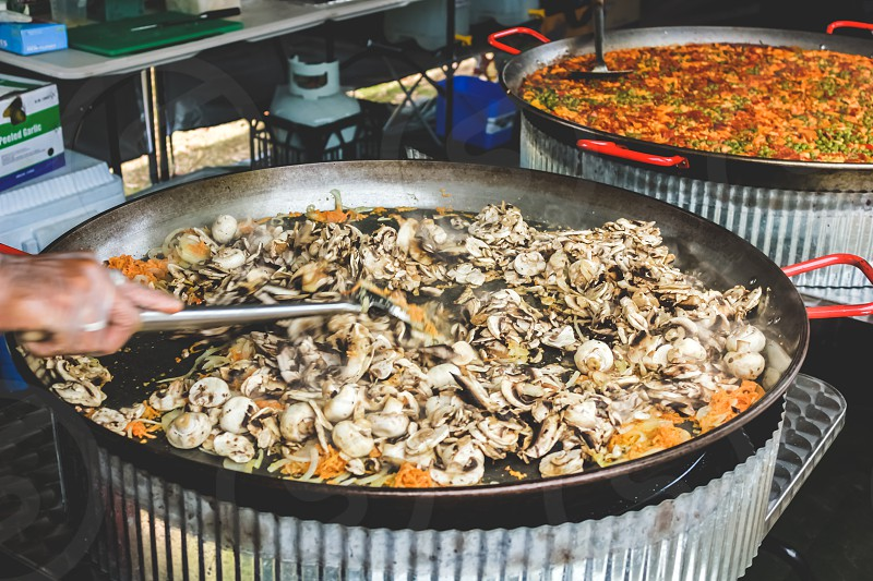 cooking in a huge pan outdoors Spanish Paella photo