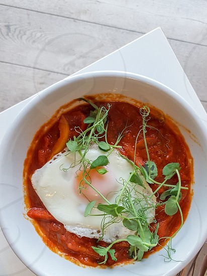 Shakshuka is a combination of eggs tomatoes and spices popular across the Middle East and North Africa photo