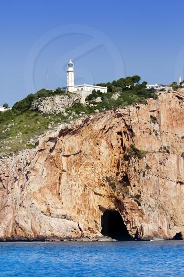 Cape Nao lighthouse white coast Alicante Mediterranean Spain photo
