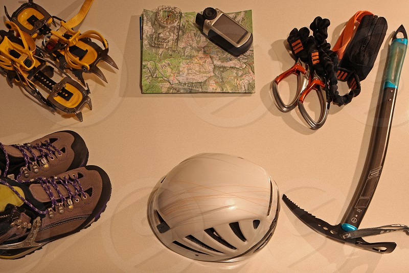 helmet near hammer and athletic shoes photo
