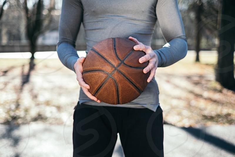 man playing basketball photo