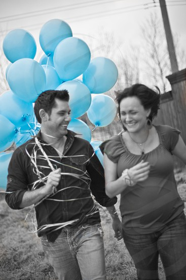 couples smiling with blue balloons photo