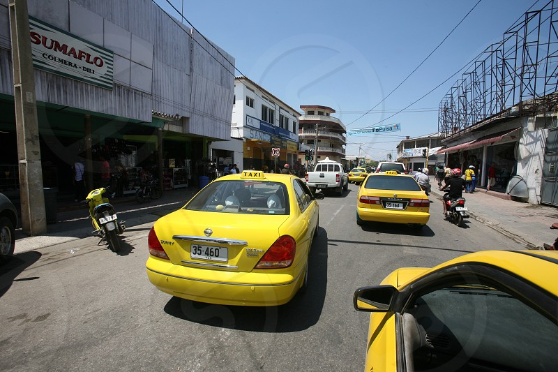 a road with taxi in the city of Dili in the south of East Timor in southeastasia.